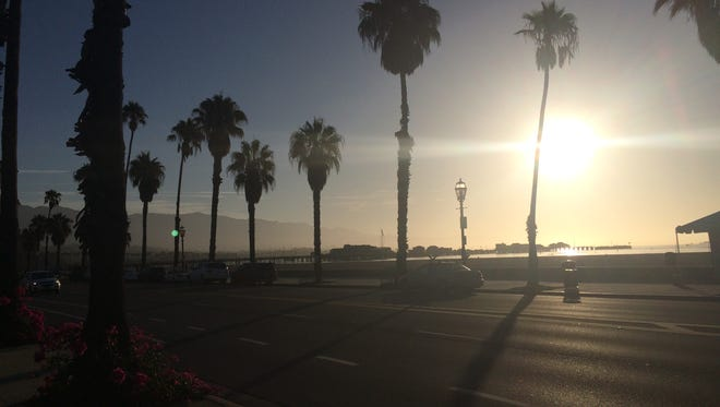 A hot sun rises over the Santa Barbara waterfront.