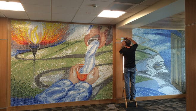 A mosaic mural in the entrance of Rice Memorial High School is part of a $12 million renovation.