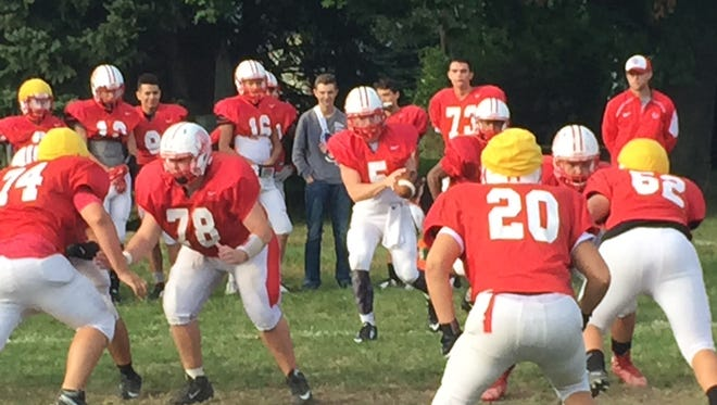 Port Clinton's Brandon Moore takes a snap at practice Wednesday.