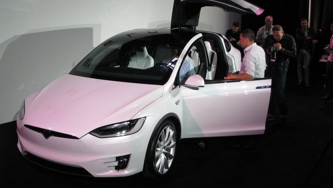 Tesla is showing its radical new Model X, with an upward opening rear door