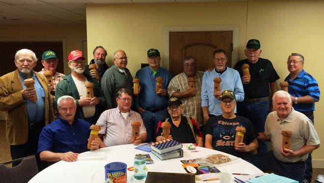 Men who served in the U.S. Army together in the mid-1960s visited Door County for their 11th annual reunion. They are holding birdhouses handcrafted by Fito Arredondo, one of their comrades who could not make the trip this year. They spent the week traveling the peninsula and going through old photos of their previous trips.