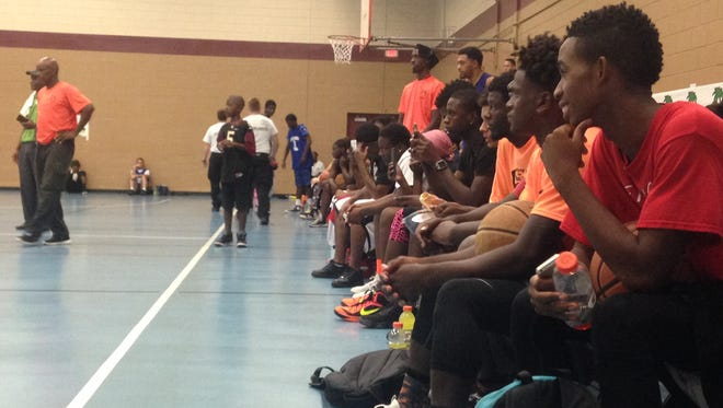 Pick up the Ball players watch a dunk competition at the Stars Complex Saturday.