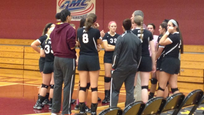 Coach Todd Humphry speaks to his Freed-Hardeman volleyball team during a 25-15, 25-15, 25-15 win over Morthland.