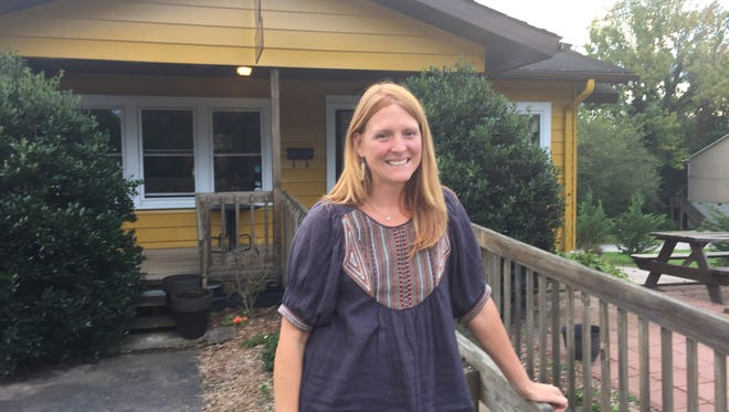 Izzy's Coffee Den owner Kristin Britton poses outside the former Waking Life Espresso location in West Asheville. Britton announced Monday she will take over the business, set to reopen in coming weeks.