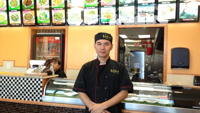 Ichiban owner Meizhen Wang stands inside of his new restaurant, located in a shopping center at the corner of Johnston Street and Broussard Road in Lafayette.