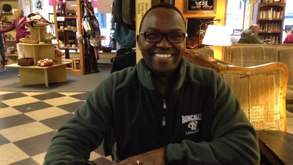 Dr. Samuel Nyamu grabs a snack at Red Rooster Coffee