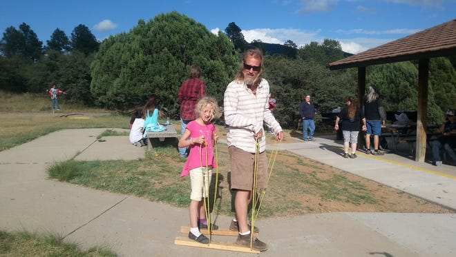 Girl Scouts of the Desert Southwest held their annual Family Day Picnic at Little Walnut Picnic Grounds on Sunday. Father and daughter team Keith and Lila Knadler of troop #321, compete in the Buddy Walkers competition.