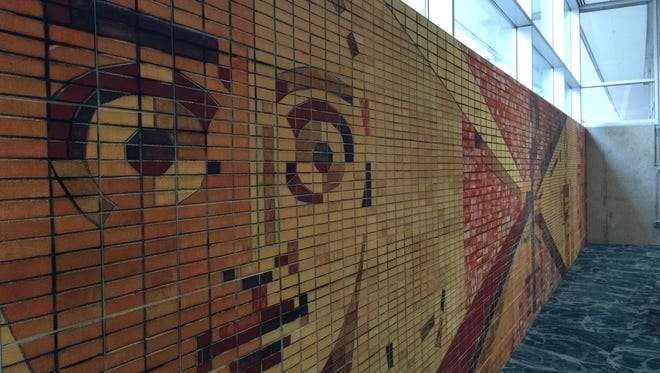 A mosaic created to resemble the murals on the Riverfront YMCA have been installed at the new Wellmark YMCA in downtown Des Moines. The Riverfront Y's brick murals were demolished when the building was imploded Oct. 4, 2015.