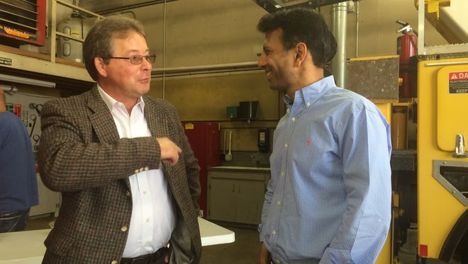 Todd Valline, director of the Chamber of Commerce and Industry for Shelby County (left), speaks  with Louisiana Gov. Bobby Jindal at Nishnabotna Valley REC in Harlan Tuesday afternoon.