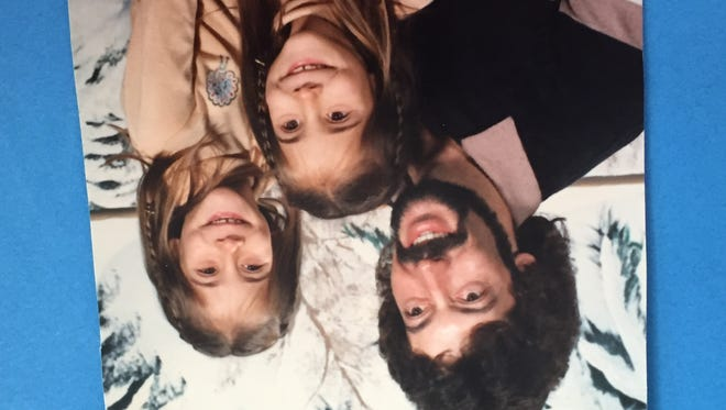 Mark Mellick is seen with his twin daughters in a picture from the 1980s.