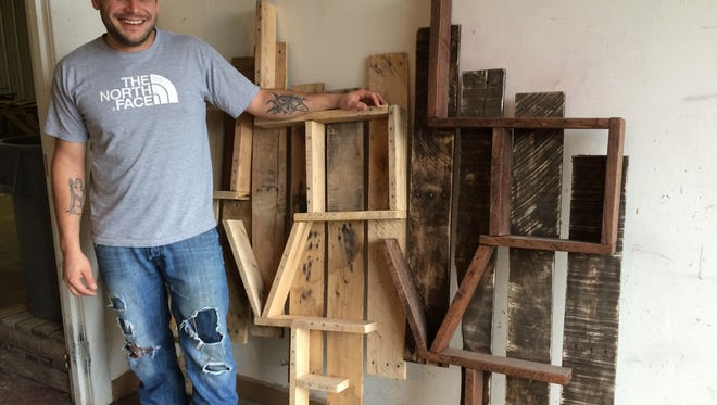 Ken Garbisch, owner of Ken's Kustom Woodworking in Rosendale builds furniture, wall-hangings and other pieces from re-purposed pallets.