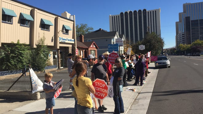 Around 20 protesters demonstrated outside the Planned Parenthood clinic on West 5th Street in Reno. Critics of the program have called for government defunding of the clinics.
