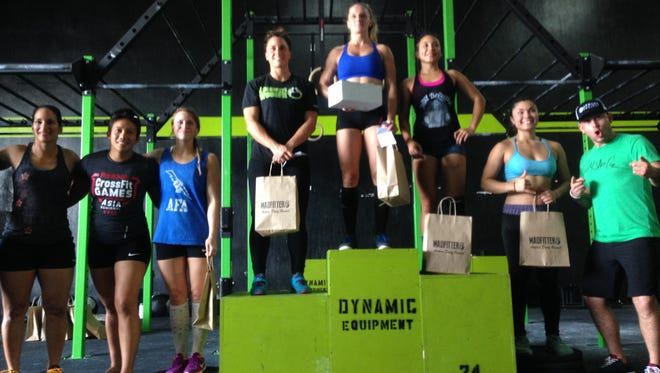 Lindsay Summerhays, center, won the fourth Marianas Trench Throwdown at Chamorri CrossFit on Sunday, Oct. 11, 2015. Summerhays won prizes from Llamas With Barbells and MadFitter.