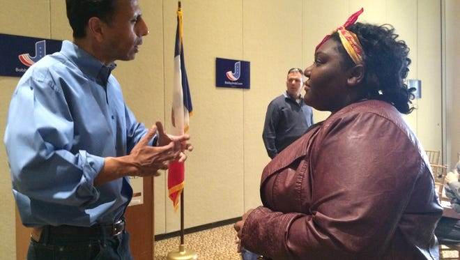 Gov. Bobby Jindal speaks with a local resident at his event at the PIPAC Centre Monday morning.
