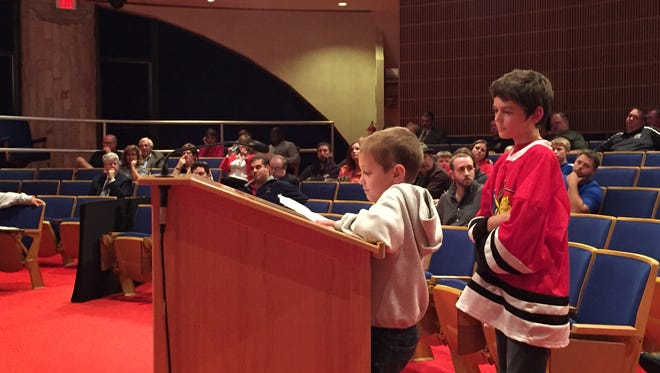 Nicklas and Jonathan Suisse, ages 7 and 12, share their support for the Port Huron Minor Hockey Assocation during public comment of the city council meeting on Monday, Oct. 12.
