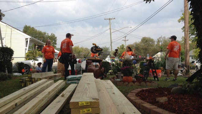 Home Depot helped disabled veteran Eugene Apple on Friday by redoing his kitchen and landscaping.