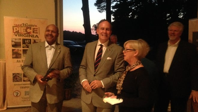 Virginia Secretary of Commerce and Trade Maurice Jones, left, Sen. Lynwood Lewis and Eastern Shore Tourism Commission Director Kerry Allison chat at a celebration for the new Virginia's Eastern Shore Artisan Trail on Thursday, Oct. 8, 2015 near Cheriton, Virginia.