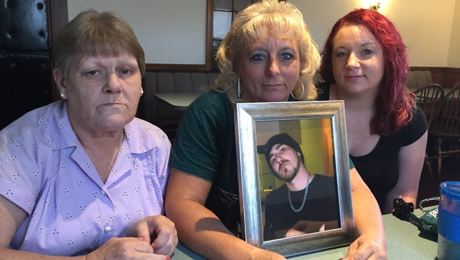 From left, Wanda Lynn North, Tammy Broadhurst and Taylor Broadhurst gather with a photo of Michael Sautter, who died Sept. 26. North is Sautter's mom, Tammy Broadhurst is his sister, and Taylor Broadhurst is his niece.