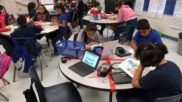 Students in a WIN Academy class read and practice spelling at Robert R. Rojas Elementary School on Oct. 12.
