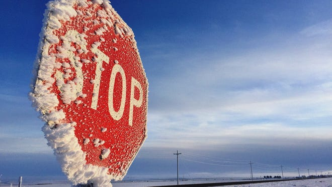 A stop sign on an icy road near Valier.