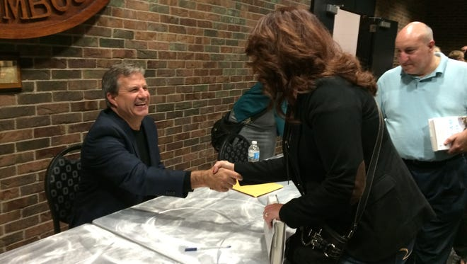 Author Sam Quinones signs books after speaking at an October 2015 event in Columbus.