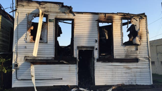 The fire on West Main Street left two vacant buildings in smolders in the early hours of Tuesday morning.  Fire crews are still investigating the cause of the fire.