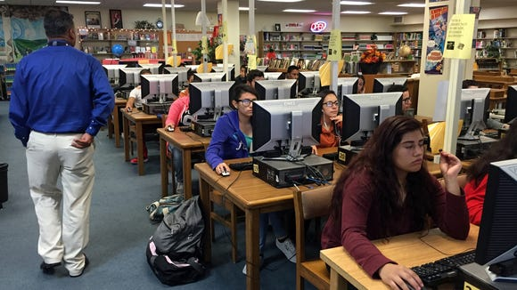 Riverside High School theater teacher Steve Solis conducts his classes using Google Classroom, an online learning platform, in the school library on Oct. 13.