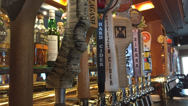 Beer taps behind the bar at Farmhouse Tap and Grill in Burlington.
