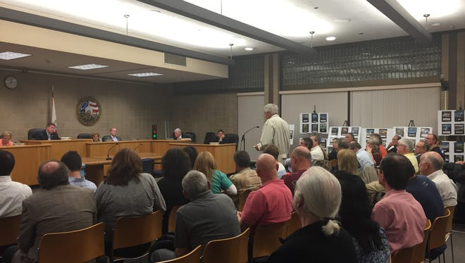 Residents at a Wednesday Township Committee meeting spoke out against the Manalapan Crossing development proposal.