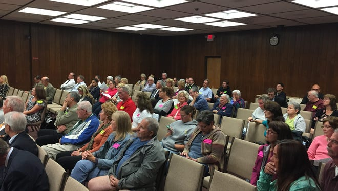 Residents gather in the Brick municipal building to protest a plan for hotel, new stores and apartments near Jack Martin Boulevard and Route 88.