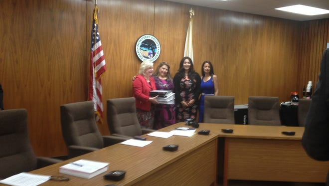 Greenfield parents from right: Leticia Martinez, Mayra Perez Diaz and Laura Caballero turn in the petition to unify to county schools superintendent Nancy Kotowski.