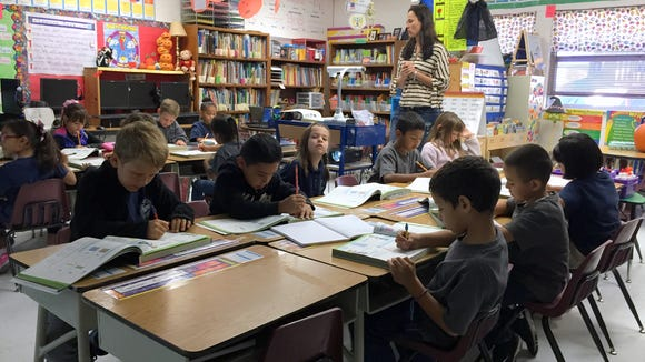 Students in Heather Atherton's first-grade class at Jose H. Damian Elementary School begin the day with math on Oct. 15.