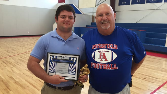 Riverfield running back Cole Morris (left) and Raiders football coach Boyd Cole accept the award for the Week 6 Cooper Buick GMC High School Hero Award. It is the second win of the season for Morris.