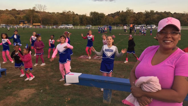 Melissa Dickinson, West Rangers team representative, helped organize Sunday's breast cancer awareness game. Breast cancer survivors will attend the event in a show of support.