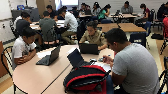 Socorro Early College High School students work on an assignment for a world geography class on Oct. 16.