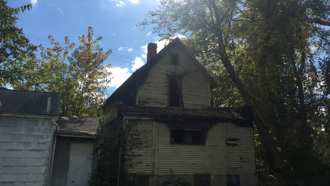 A vacant house at 123 E. 2nd St. caught fire late Saturday, and the fire spread to a neighboring property.