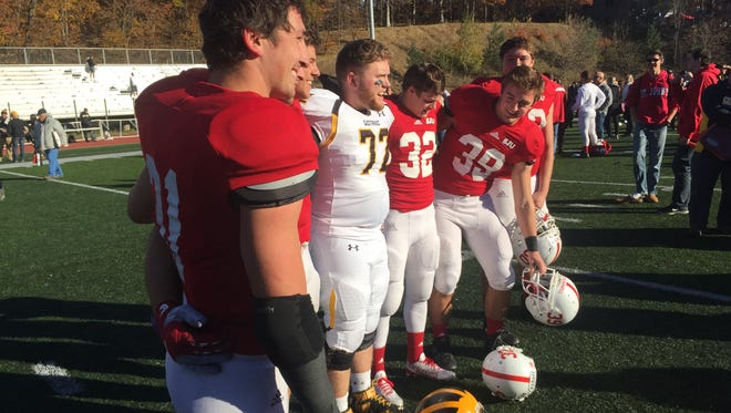Sam Sura and other South St. Paul graduates gather for pictures after St. John's defeated Gustavus Saturday afternoon at Clemens Stadium