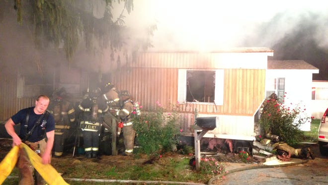 Three early morning fires destroyed one home and damaged two others in a  Stanton mobile home park in what officials are calling arson.