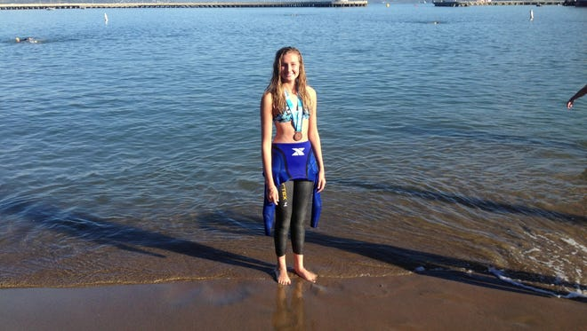 Williams Field High School sophomore Emily Thomas completed the Alcatraz and Golden Gate Bridge swims in spring 2015 a day apart. She is eyeing the Statue of Liberty swim in spring 2016.