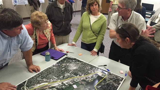 Wabash River Enhancement Corp. Executive Director Stan Lambert discusses redevelopment ideas Tuesday during an open house. The public input is part of the master plan process for land east of the river between Sagamore Parkway and the Harrison Bridge.