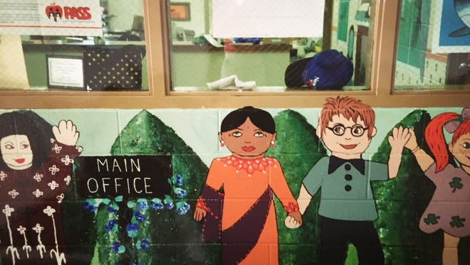 A photo of the Asher Holmes mural taken by art teacher David Wells in the 1970s.
