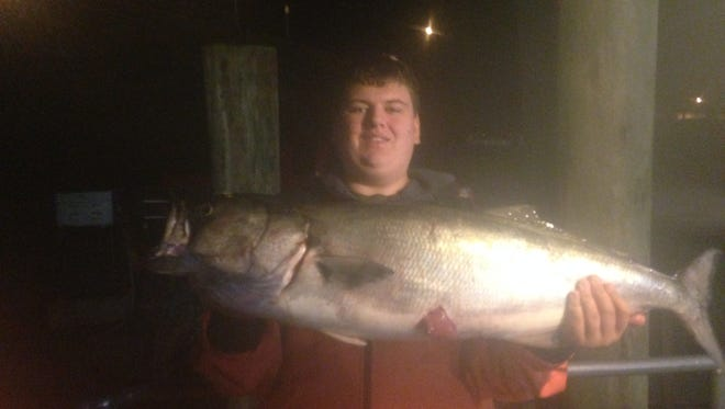 Quinn Figueroa, 14 of Manchester, holds up a 22 1/2-pound bluefish he caught on the Paramount.