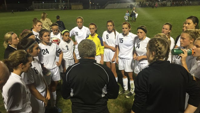 The River View girls soccer team speaks with coach Dave Kridler after a 3-0 win at home against Dover.