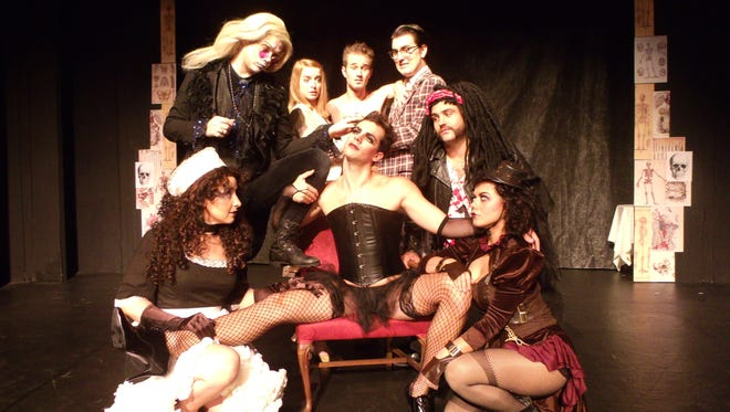 """The cast of """"The Rocky Horror Show"""" includes, from the left, Val Roche as Magenta, Ryan Bowie as Riff Raff, Lindsay Nantz as Janet Weiss, Sean Michael Jaenicke as Rocky, James Hansen as Dr. Frank N. Furter, Timothy Michael Houston as Brad Majors, Matthew Smolko as Eddie, Kelley Barker as Columbia. The show returns to the Roxy this year for its fourth season."""