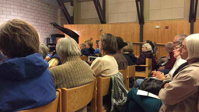 Audience members listen to the Fort Collins Interfaith's panel on affordable housing Thursday, Oct. 22, 2015.