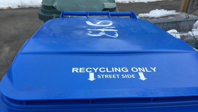 The city's big blue recycling cart, which now goes to the street every other week.