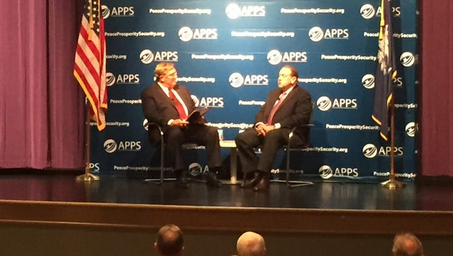 Former Arkansas Gov. Mike Huckabee (right) discussed national security at a forum at Greenville Tech on Friday.
