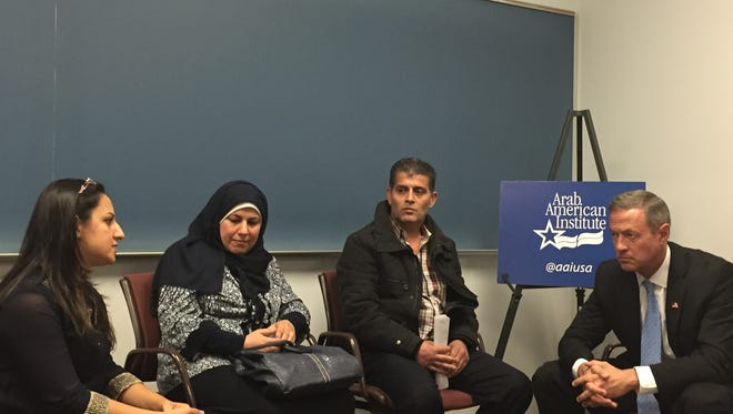 Gov. Martin O'Malley, Democratic presidential candidate, listens to Syrian and Iraqi refugees in Dearborn