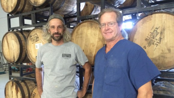 Head brewer Drew Perry (left), of Fishtown and co-founder Dr. Robert Dalsey of Haddonfield are ready to celebrate their first year in business.
