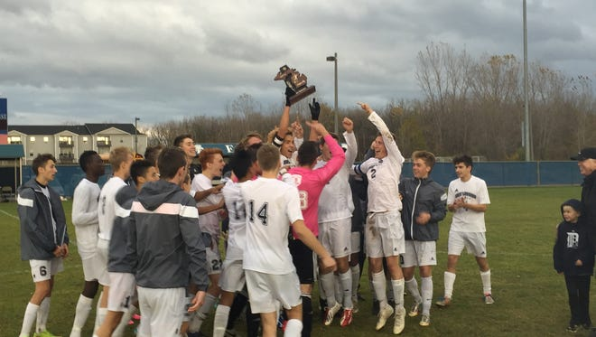Eat Lansing boys soccer captures its fourth consecutive district title with a 3-2 win over Haslett on Saturday.